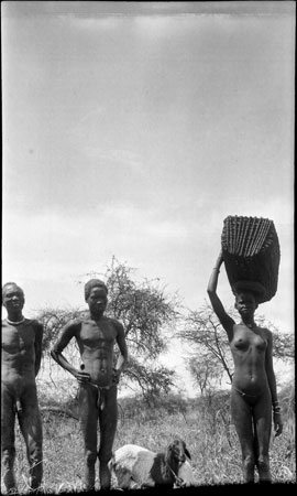Nuer woman carrying basket