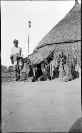 ?Nuer women outside hut