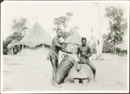 Zande youths with drum and gong