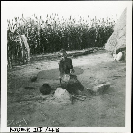 A Nuer woman cooking