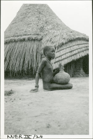 Nuer girl with gourd