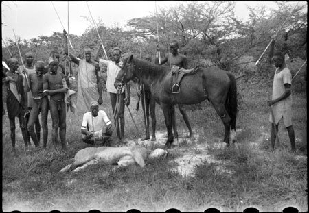 Nuer porters with lion